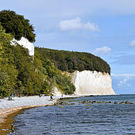 View from the beach to the chalk cliffs in the Jasmund National Park.