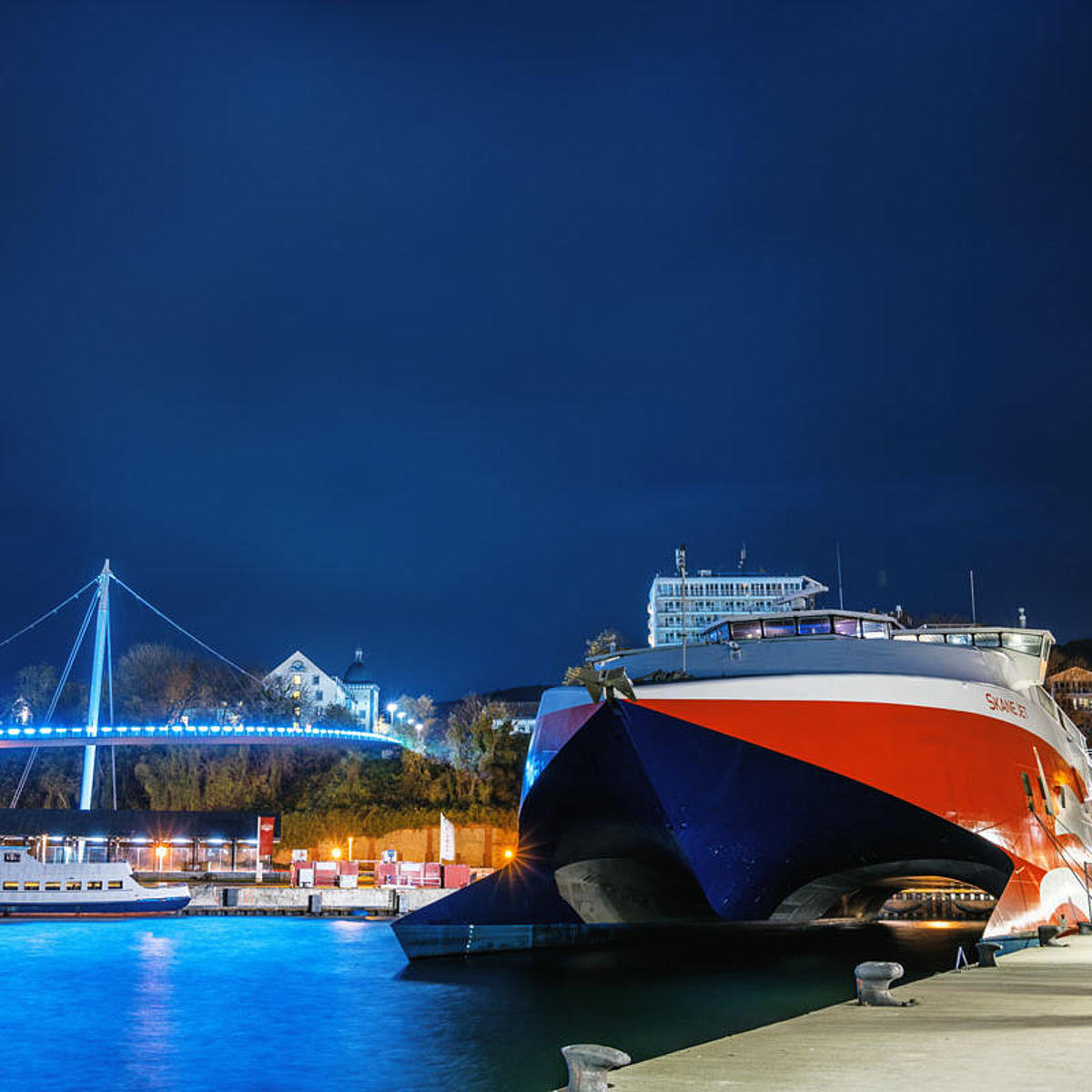 Skane Jet in the city harbour of Sassnitz by night.
